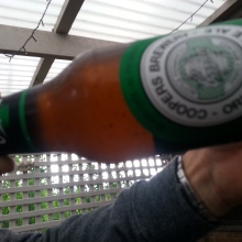 Coopers. Brewed in the bottle so there is yeast sludge in every bottle. Roll the bottle to mix before opening.