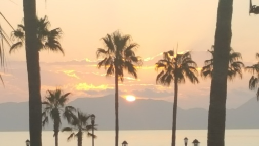 Sun over the Sea of Cortez brings peach lit skys